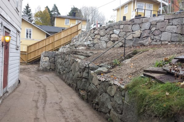 A pathway beside a stonewall
